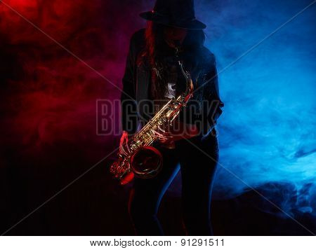 Beautiful Young Woman Plays Saxophone