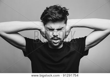 I need silence. Frustrated young man in shirt