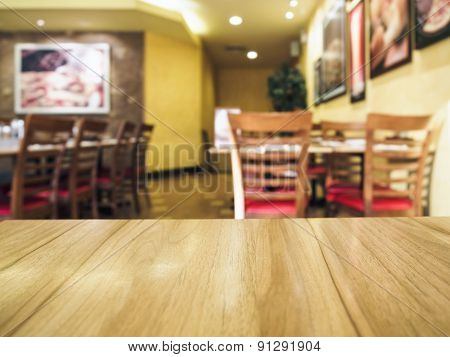 Table top counter with pizza restaurant background
