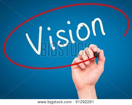 Man Hand writing Vision with marker on transparent wipe board.