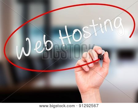 Man Hand writing Web Hosting with marker on transparent wipe board.