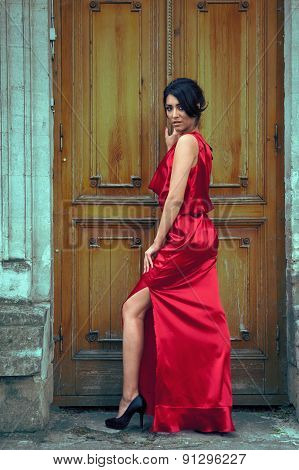 Sexy Woman In Red Dress In Front Of Door