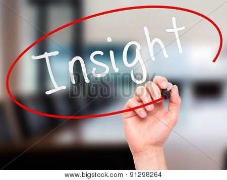 Man Hand writing Insight with marker on transparent wipe board