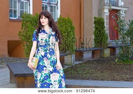 Beautiful Woman In Long Dress Walking In Old Town Of Tallinn, Estonia