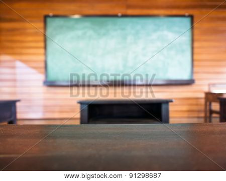Blackboard With Top Of Table, Education Blurred Background