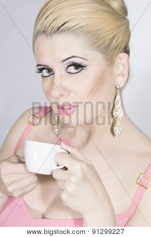 The Girl In Pink With A Cup Of Coffee