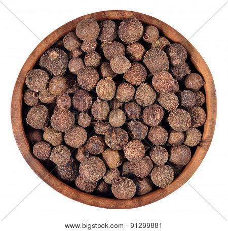 Allspice In A Wooden Bowl On A White