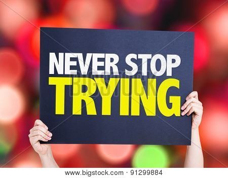Never Stop Trying card with bokeh background