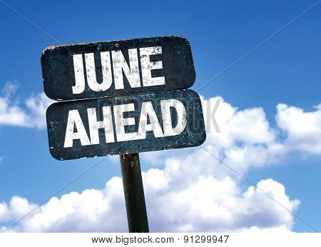 June Ahead sign with sky background
