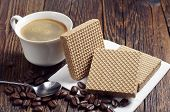 image of condensation  - Coffee cup and wafers with caramelized condensed milk on dark wooden table - JPG