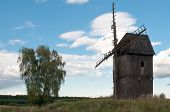 Old, Weathered Wooden Windmill In Polish Countryside poster