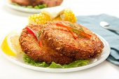 foto of patty-cake  - Large dinner sized salmon croquettes served with corn - JPG