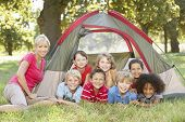 picture of tent  - Group Of Children With Mother Having Fun In Tent In Countryside - JPG