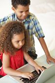 picture of ten years old  - Children Using Laptop At Home - JPG