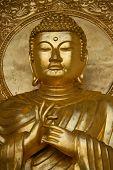 stock photo of siddhartha  - Close up of gold Budha statue in Peace Pagoda Battersea Park Wandsworth London UK - JPG