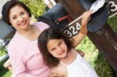 foto of grandmother  - Hispanic Grandmother And Granddaughter Checking Mailbox - JPG