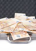 stock photo of fifties  - Suitcase full of fifty euro bank note bills isolated over the white background - JPG