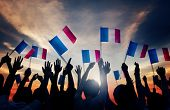 foto of french culture  - Group of People Waving French Flags in Back Lit Concept - JPG