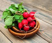 image of radish  - Fresh organic radish on a old wooden background - JPG
