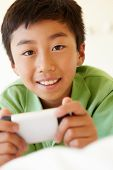picture of pre-teen boy  - Young boy using smartphone - JPG