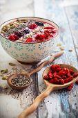 image of blackberries  - Breakfast berry smoothie bowl topped with goji berries - JPG