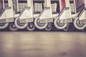 pic of trolley  - Close up trolleys luggage in a row in airport retro filter effect - JPG