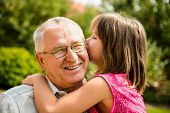 pic of ear  - Little girl whispering her grandfather a secret to ear  - JPG