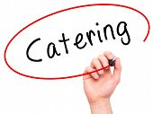 picture of catering  - Man Hand writing Catering with marker on transparent wipe board - JPG