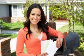 picture of mailbox  - Worried Hispanic Woman Checking Mailbox - JPG
