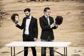 picture of beheaded  - Two guys holding mannequin heads in Shakespearian fashion  - JPG
