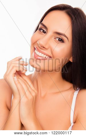 Portrait Of Beautiful Young Woman Touching Her Hands