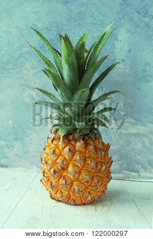 Fresh Pineapple on a rustic blue and white background