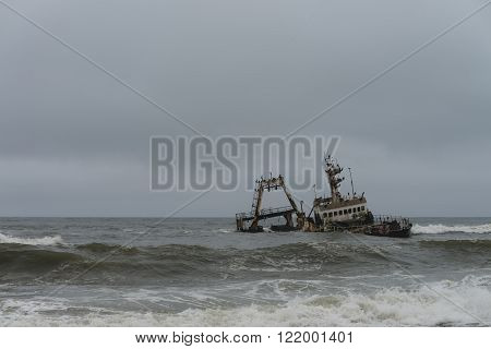 Shipwreck at the Skelleton Coast (Namibia) during a stormy day