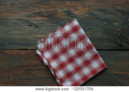 Napkin on a rustic wooden background   french country style