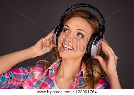 Close Up Portrait Of Music Fan Listenung Music In Headphones