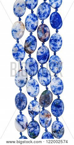 beads from blue lazurite gem stone isolated on white background