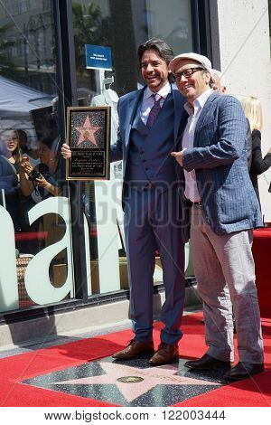 LOS ANGELES - MAR 10: Mexican actor Eugenio Derbez, Rob Schneider at a ceremony where Eugenio Derbez is honored with a star on the Hollywood Walk of Fame on March 10, 2016 in Los Angeles, California