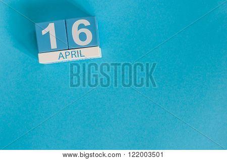 April 16th. Image of april 16 wooden color calendar on white background.  End month. Spring day, emp