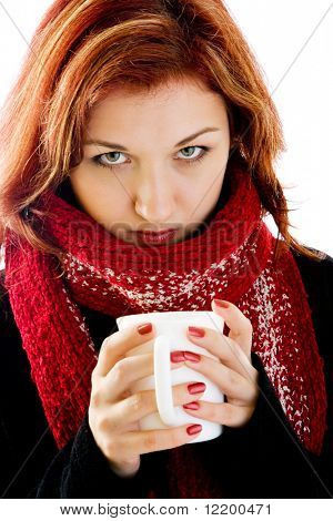 portrait of girl in winter clothes with cup