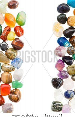 vertical frame from natural mineral gemstones with blank space isolated on white background
