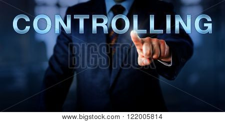 Manager touching CONTROLLING on an interactive screen. Business metaphor and managerial control concept for performance measurement in relation to predetermined corporate standards goals and plans.