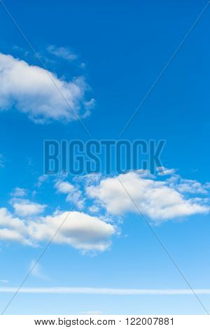 Blue Sky With Clouds And Horizontal Airplane Trace