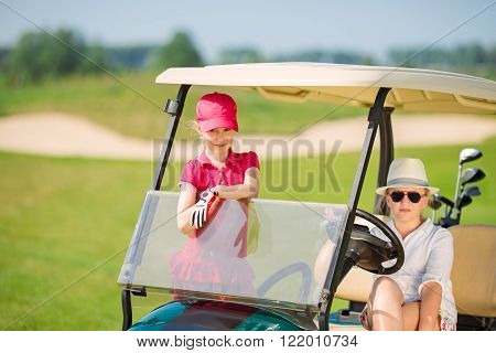 Kids on golf
