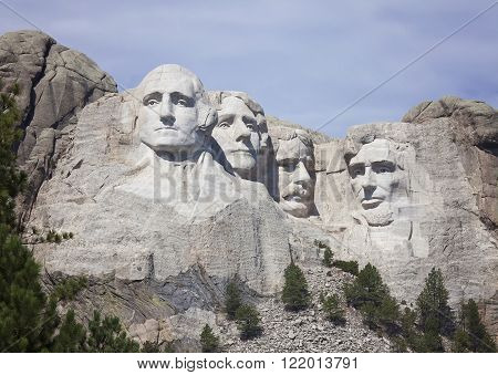 Mount Rushmore National Monument with light overcast sky.  South Dakota Vacation