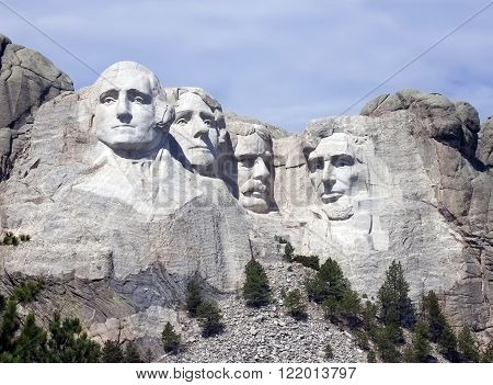 Mount Rushmore National Monument under lightly overcast sky.  South Dakota vacations.