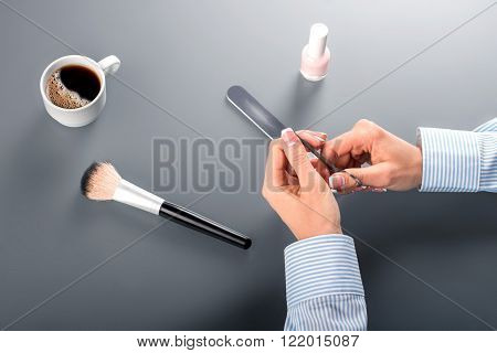 Woman's hands with manicure scissors. Businesswoman using manicure scissors. Careful with the sharp metal. And now the scissors.