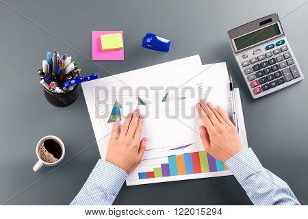 Lady's hand with white envelope. White envelope on accountant's table. Time to send the report. Let's pass good news.