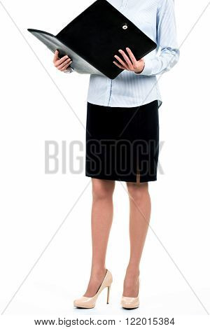 Lady holding opened leather folder. Businesswoman with opened black folder. Remind me the details. Looking through today's agenda.