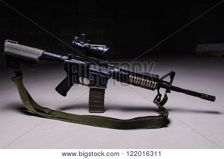 Army assault rifle with optical sight and tactical belt
