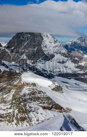 clouds covering Swiss Alps near Mount Matterhorn, Canton of Valais, Switzerland